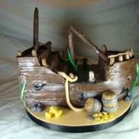 "Sunken Pirate Ship Cake is covered in modeling chocolate. ""Booty"" is fondant. This is the most fun I've had making a cake in a long time...."