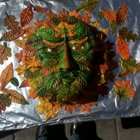 Green Man Cake Cake to depict the green man, which is a nature spirit, represented with either being made of leaves, fruit/veggies or other vegetation....