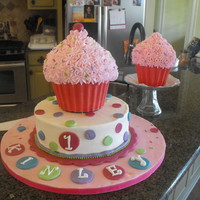 Cup Cake Birthday Cake I made this for my granddaughter's 1st Birthday. The smaller cup cake was her's to have fun with and boy did she. She had to have...