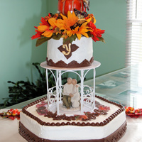 """fall"" In Love Vanilla almond cake with buttercream frosting...chocolate fondant accents, silk flowers, Wilton Gazebo divider, Willow Tree Couple"