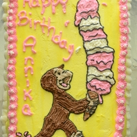 "Curious George With Ice Cream 13 x 9"" cake. Cut out a picture my daughter liked and traced around it on the frosted cake with toothpick. Filled in with buttercream..."