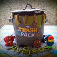 Trash Pack Birthday Cake Loved making this cake for my Godchild!Little monsters are made with gum paste!