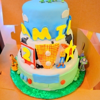 Toy Story For Her I made this 3-tier cake for a 2-year old girl who loves TOy Story!