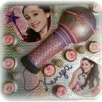 Ariana Grande Cake I did this with a custom made cake board it is all Fondant with ice cream cone microphone cake pops and butter cream cup cakes. Tags:...