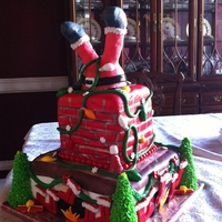 Santa Cake I made this for a company Christmas party, the stockings have every the names of the people that work there. Santa is made out of rice...