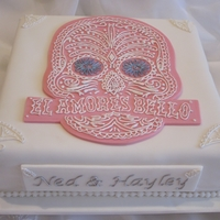 White Square Engagement Cake With Skull Outline This was requested by a friend, an Engagement Cake with a skull outline which I copied from their Engagement Invitation. This is my first...