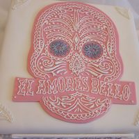 White Square Engagement Cake With Skull Outline