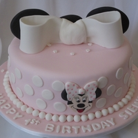 Mini Mouse Cake This cake is a marble cake covered in pink fondant with white poka dots. The ears are black fondant with a fondant bow. Mini Mouse's...