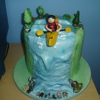 Kayaking 4 layer vanilla spongecake with buttercream filling. all models and accents are modelled with sugarpase/gumpaste.. i copied this from a...