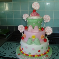 Another Candy Cake these sweetie cakes seem to be so popular, i have made several i the past few months. lollipops are marshmallow and strawberries and bows...