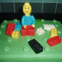 Lego vanilla spongecake filled with strawberry jam and vanilla buttercream. the lego man and lego pieces are fondant