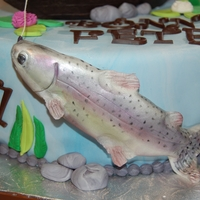Rainbow Trout   A cake I made for a man who love fishing. The have a burmese mountain dog that cannot swim also!