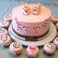 Leopard Print Baby Shower Cake With Cupcakes   Leopard print baby shower cake, with cupcakes.