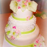 Calla Lilly Wedding Cake   Beautiful Wedding Cake. Simple white cake with butter cream. By far my favorite so far !