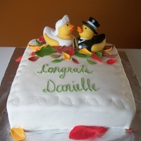 Bridal Shower Duckies 10 inch WASC cake with chocolate buttercream filling, buttercream and MMF on the outside. Leaves made out of fondant/gumpaste mix. Love...
