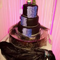 Black And Purple Wedding Cake The bride and groom have a unique style and wanted a black wedding cake. It was based on a sophie bifield cake, a picture the bride seen...