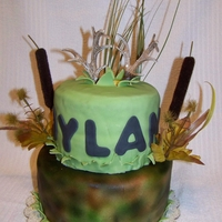 Deer Hunter Fondant, 2 tier birthday cake with deer antlers.