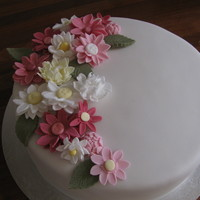 Flowers For The Lady Assorted Sugar Daisies and Vanilla Cake filled with Vanilla Buttercream and covered in fondant
