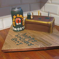 "Beer Having A Beer! Vanilla Cake with a Krispy Treat Beer Can (stood 7"" tall) on a fondant wood covered aboard. Great fun cake to make!"
