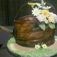 Old Rusty Watering Can   This is a cake that was made for a live decorating contest.