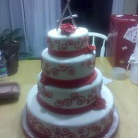 Red/white Wedding Cake Red velvet cake with white fondant and red buttercream icing decorations.