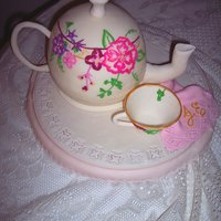 Floral Tea Pot With Tea Cup   White almond cake with vanilla Italian meringue buttercream and vanilla almond mmf. Gum paste tea cup