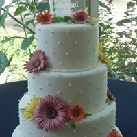 Daisies Three tier cake dummy for a wedding.