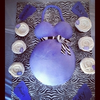 Belly Cake. Mom wanted purple and zebra print. maersmallow fondant and wilton zebra print sugar sheets. the board is covered in duck tape with plastic...