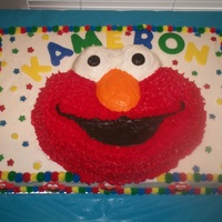 Elmo elmo pan on top if 12x18 sheet. vanilla and chocolate cake with vanilla almond buttercream and fondant and sprinkle accents