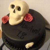 Skulls And Roses   THIS WAS MADE FOR AN 18 YEAR OLD GIRLS BIRTHDAY, THE SKULL ON TOP WAS CHOCOLATE CAKE AND SOME WHITE CHOCOLATE MOULDED SKULLS ON THE SIDES