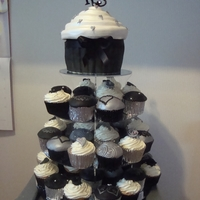 Engagement Cupcake Tower  THIS WAS MADE FOR MY NEPHEW'S ENGAGEMENT PARTY. THE COLOUR THEME WAS SILVER, BLACK WHICH I INCORPORATED IN THE CUPCAKES,SOME WERE...