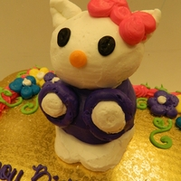 Hello Kitty   one jumbo cupcake and one regular sized cupcaked stacked and decorated and sculpted with buttercream icing