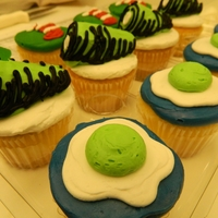 Green Eggs And Ham cupcakes decorated with buttercream icing