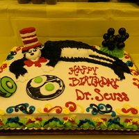 The Cat In The Hat full sheet cake which serves 96 people decorated with buttercream icing. The cat in the hat, and green ham are made with cupcakes decorated...