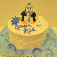 Frozen Birthday   8 inch double layer round decorated with buttercream icing. penguin is made out of a cupcake and buttercream icing
