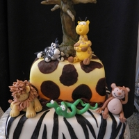 Welcome To The Jungle   three tier fondant covered cake. fondant and marzipan hand sculpted animals. pastiage tree.