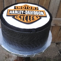 Harley Logo Tire Cake This is a Banana cake with Buttercream icing and a Banana Cream filling. The cake was baked using a collar of parchment paper around my 10&...