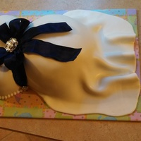 Maternity Belly Cake Pumpkin Spice cake with Buttercream icing and Liz Merek's MMF. I had done the wedding cake this past summer for the happy couple and...