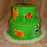 Jungle Animals Baby Shower Cake 6-inch lemon cake tier and 8-inch yellow cake tier. Buttercream frosting with marshmallow fondant details. Made for a baby shower with a &...