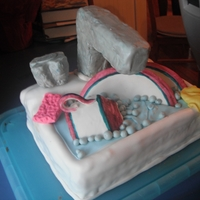 Kitchen Sink Gumpaste dishes, rice cereal faucet and handles covered with fondant. Sponge and dish towel are also fondant.
