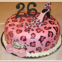 Pink Leopard Diva  10 inch round covered in fondant. Hand painted leopard print with gumpaste shoe. The design was actually much easier to paint than I...