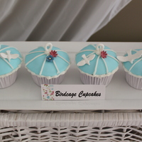 Birdcages Cupcakes with fondant top and royal icing piped cage
