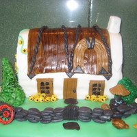 Irish Cottage This is an Irish Cottage cake, inspired by one that I saw here in one of the galleries. The decorations are all fondant, bc.