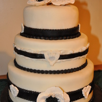 Black And White Wedding Cake Sassy and classy, black and white was the style of this wedding cake! Bottom layer was chocolate fudge cake with chocolate ganache butter...