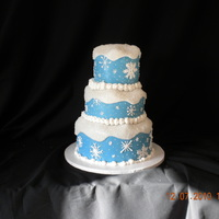 Snow Flakes Fondant covered cake with snow flakes piped on with royal icing. Carved and coated with crystal sugar for snow effect.