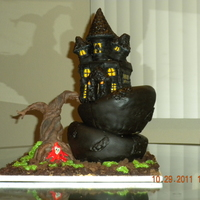 Haunted House Topsy turvy, haunted house cake covered in chocolate fondant. Modeling chocolate tree inspired by the film Sleepy Hollow.
