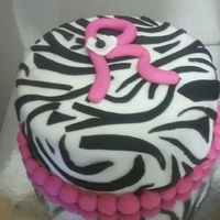 Zebra Birthday Cake & Cupcakes For a little girl that requested a Vanilla Zebra Cake. Buttercream and Fondant. Matching cupcakes.