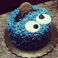Cookie Monster Smash Cake Cookie Monster Smash Cake for a one year old. Chocolate cake with buttercream icing and a chocolate chip cookie. Fondant eyes.