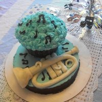 Trumpet/music Cake The mouthpiece and the bell come on and off. I wasn't able to set up this cake, so two of the trumpet detail pieces are not in the...