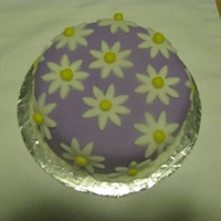 White Daisies On Purple.   First time using fondant.